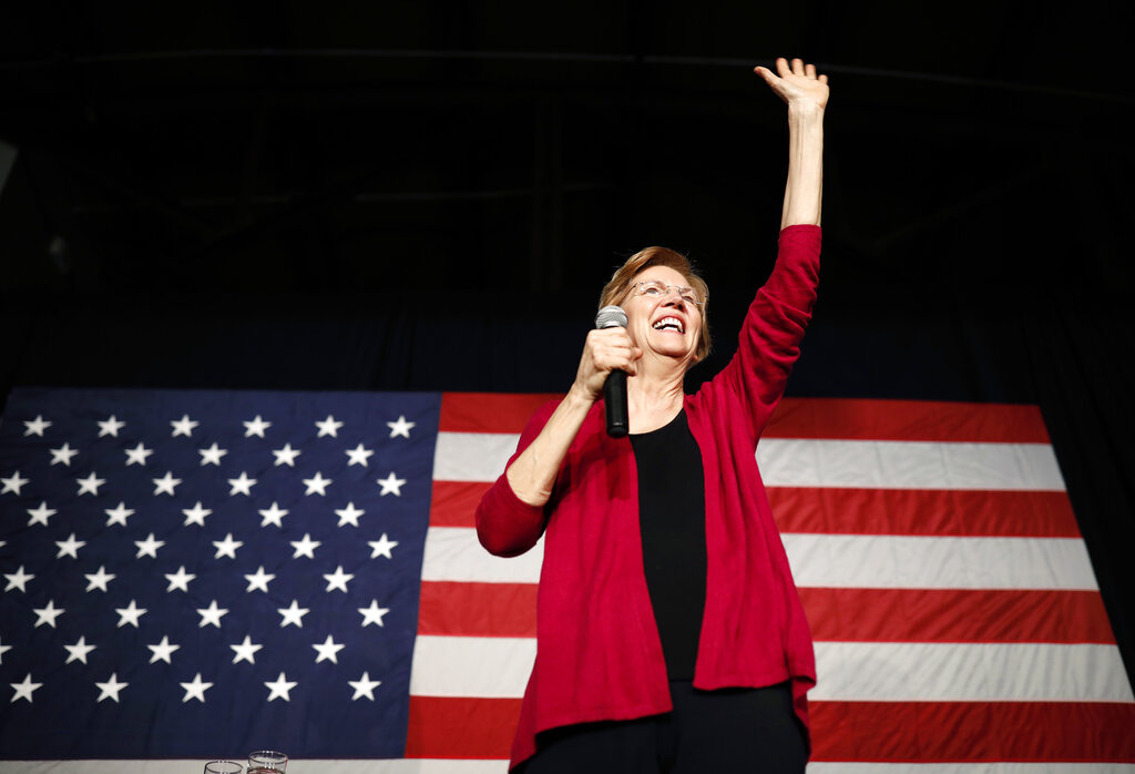 Sen. Elizabeth Warren, D-Mass, waves to the crowd during an organizing event at Curate event space in Des Moines, Iowa. (AP Photo/Matthew Putney, File)