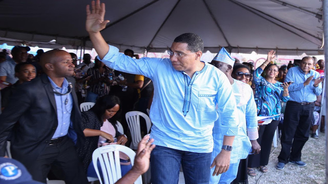 Prime Minister Andrew Holness acknowledges the gathering at the celebration.