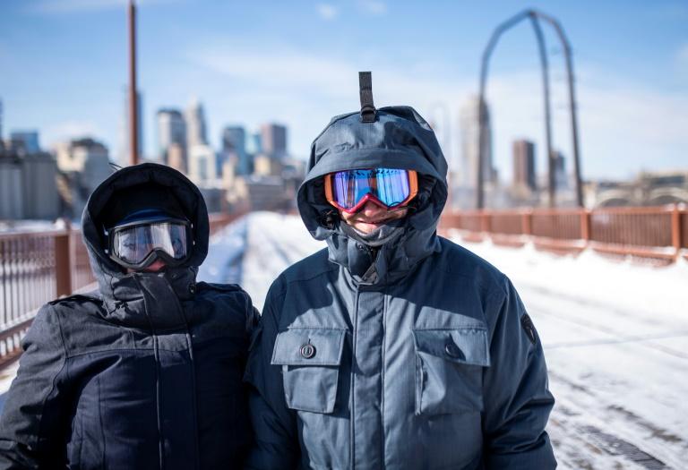 Des piétons bravent le froid à Minneapolis, le 29 janvier 2019 dans le Minnesota