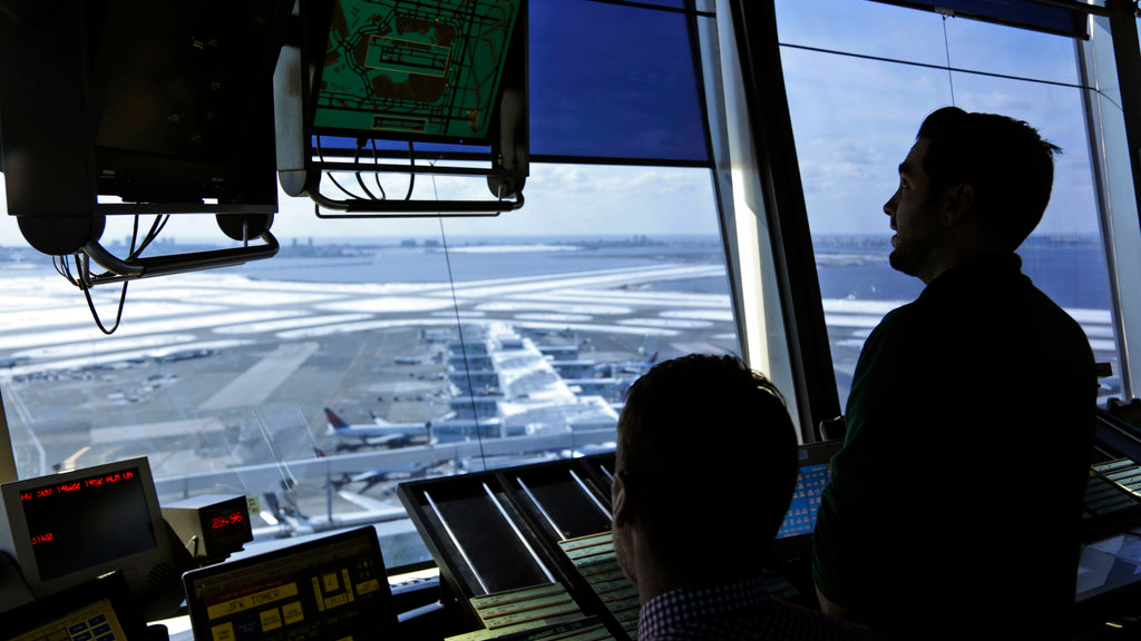 In this March 16, 2017, file photo, air traffic controllers work in the tower at John F. Kennedy International Airport in New York. (AP Photo/Seth Wenig, File)