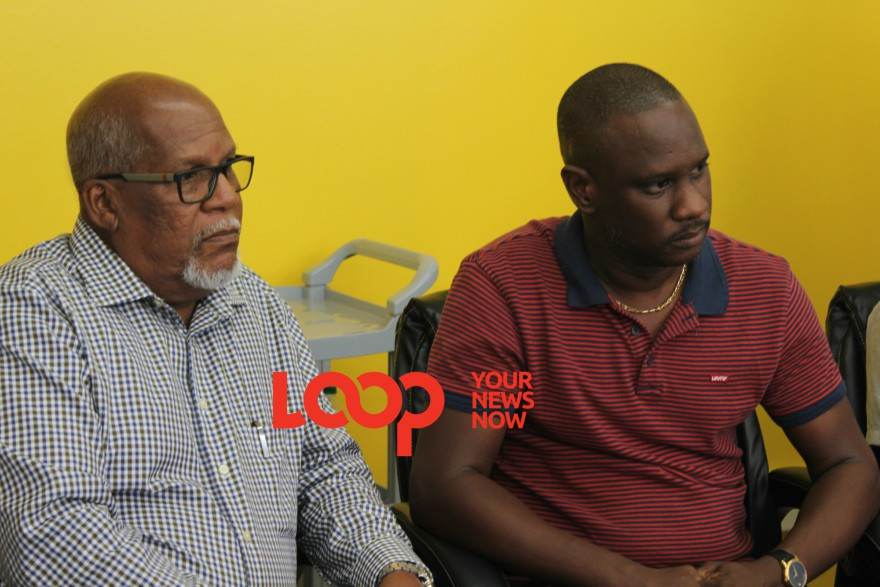 Chairman of the Transport Authority, Ian Estwick (left) and PRO of the PSV Workers Association, Fabian Wharton (right).