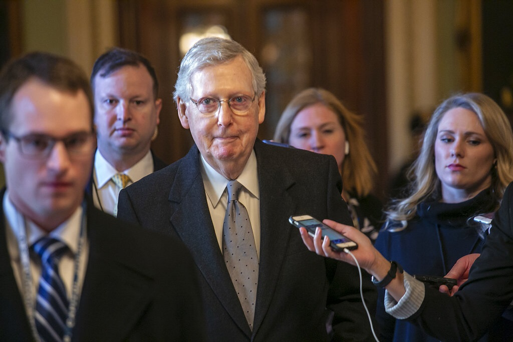 Senate Majority Leader Mitch McConnell, R-Ky., leaves the chamber after speaking about his plan to move a 1,300-page spending measure, which includes $5.7 billion to fund President Donald Trump's proposed wall along the U.S.-Mexico border. (AP Photo/J. Scott Applewhite)