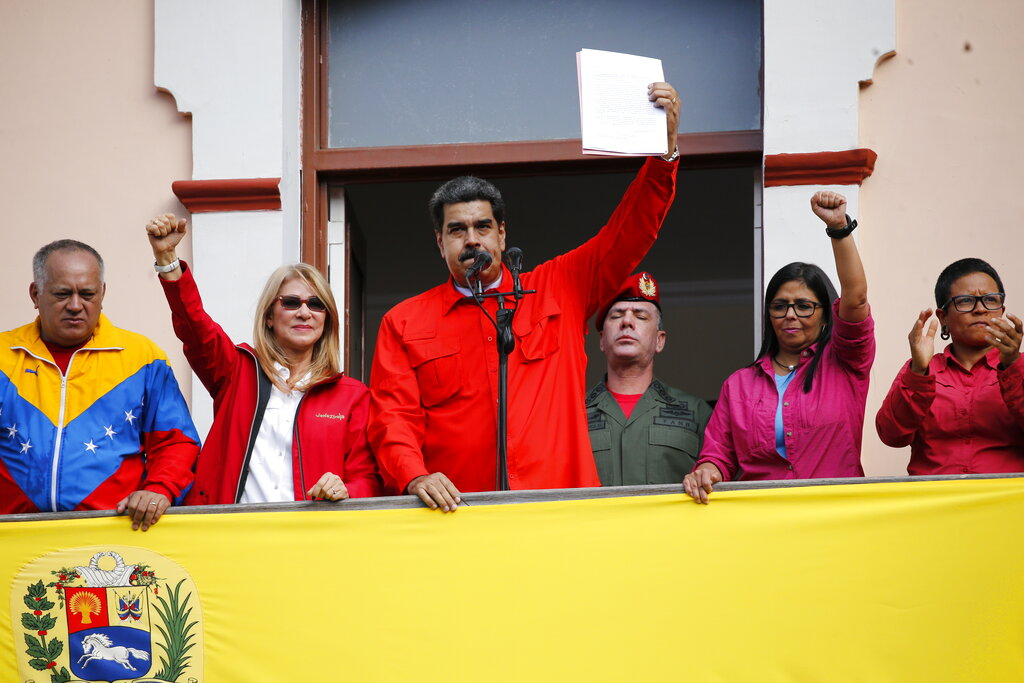 Venezuelan President Nicolas Maduro announces he is breaking relations with the U.S., to supporters from a balcony at Miraflores presidential palace in Caracas, Venezuela, Wednesday, Jan. 23, 2019. Maduro is giving American diplomats 72 hours to abandon the country after breaking diplomatic relations with the U.S. over its decision to recognize an opposition leader as interim president. (AP Photo/Ariana Cubillos)