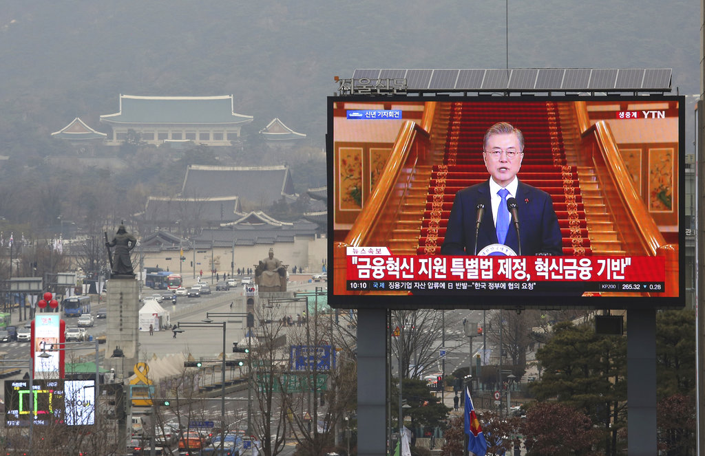 A TV screen shows the live broadcast of South Korean President Moon Jae-in's press conference in Seoul, South Korea, Thursday, Jan. 10, 2019. (AP Photo/Ahn Young-joon)