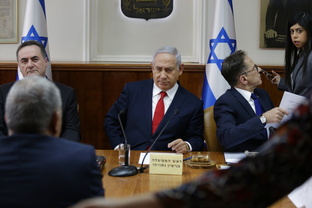 Israeli Prime Minister Benjamin Netanyahu, center, ‏convenes his cabinet for weekly meeting in Jerusalem, Sunday, Jan. 13, 2019. (AP Photo/Ariel Schalit, Pool)