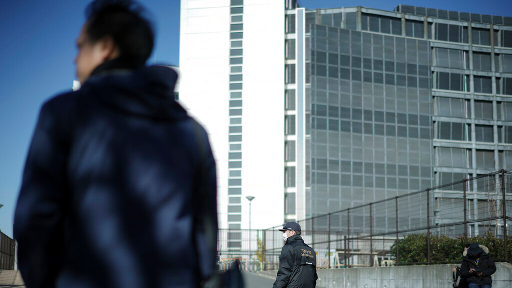 A security official stands guard in front of Tokyo Detention Center, where former Nissan chairman Carlos Ghosn is detained, in Tokyo Friday, Jan. 11, 2019. Ghosn has recovered from a fever, his lawyer Motonari Ohtsuru said Friday as the 64-year-old executive's latest detention period was set to expire. (AP Photo/Eugene Hoshiko)