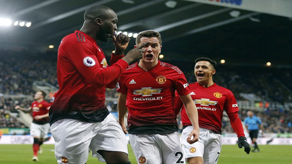 Manchester United's Romelu Lukaku, left, celebrates with teammates after scoring his side's first goal of the game against Newcastle United during a Premier League football match at St James' Park, Wednesday, Jan. 2, 2019, in Newcastle, England.