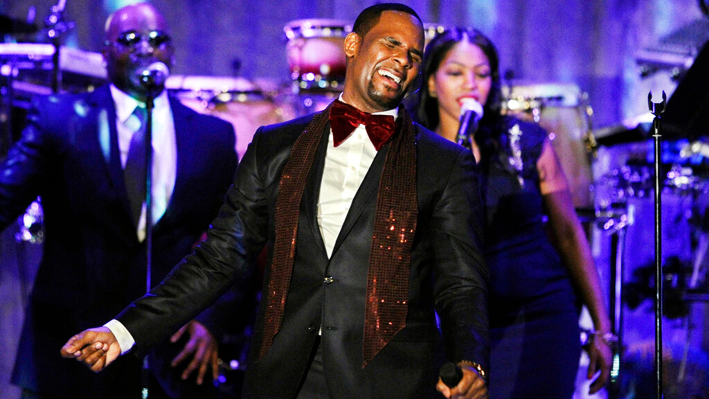FILE - This Feb. 12, 2011 file photo shows R. Kelly performing at the pre-Grammy gala & salute to industry icons with Clive Davis honoring David Geffen in Beverly Hills, Calif. Kelly, one of the top-selling recording artists of all time, has been hounded for years by allegations of sexual misconduct involving women and underage girls _ accusations he and his attorneys have long denied.  (AP Photo/Mark J. Terrill, file)