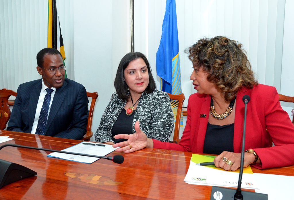 From left to right: Nigel Clarke, Minister of Finance and the Public Service, and Adriana La Valley, Chief of Operations at the Inter-American Development Bank, IDB, listen to Diane Edwards, President of JAMPRO after the official signing ceremony for the Global Services Skills agreement.