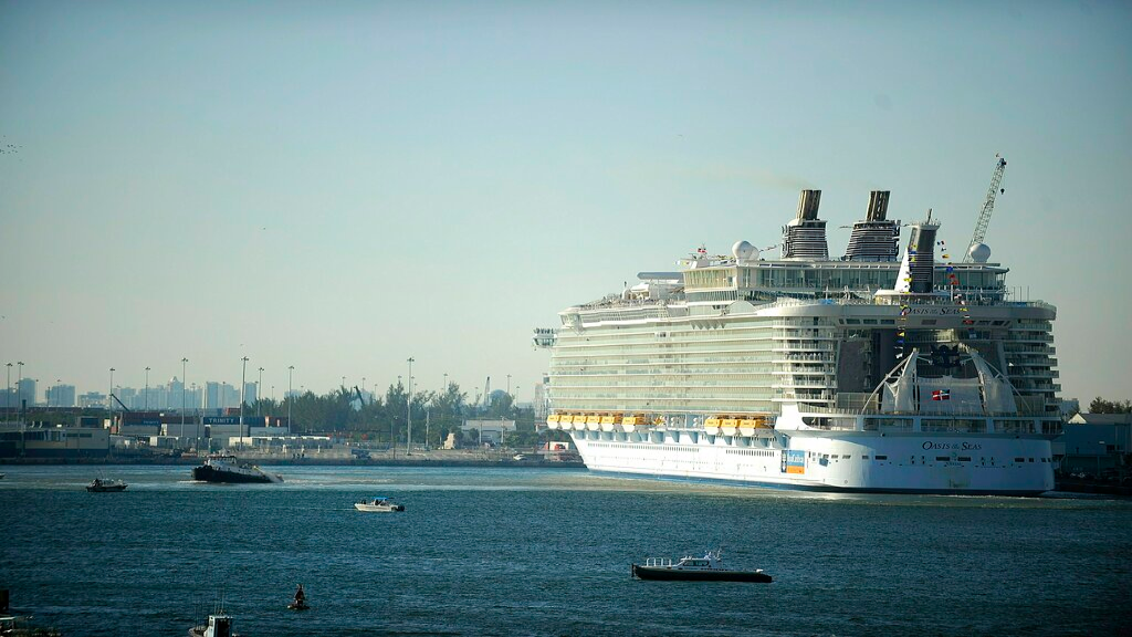 FILE - In this 2009, file photo, Royal Caribbean's Oasis of the Seas cruise ship is docked at Port Everglades in Fort Lauderdale, Fla. The ship is returning to a Florida port a day early and giving passengers full refunds of their fare after 277 guests and crew members were hit with an outbreak of Norovirus as it sailed to Jamaica. The ship is expected to arrive in Port Canaveral on Saturday, Jan. 12. (Josh Ritchie/South Florida Sun-Sentinel via AP, File)