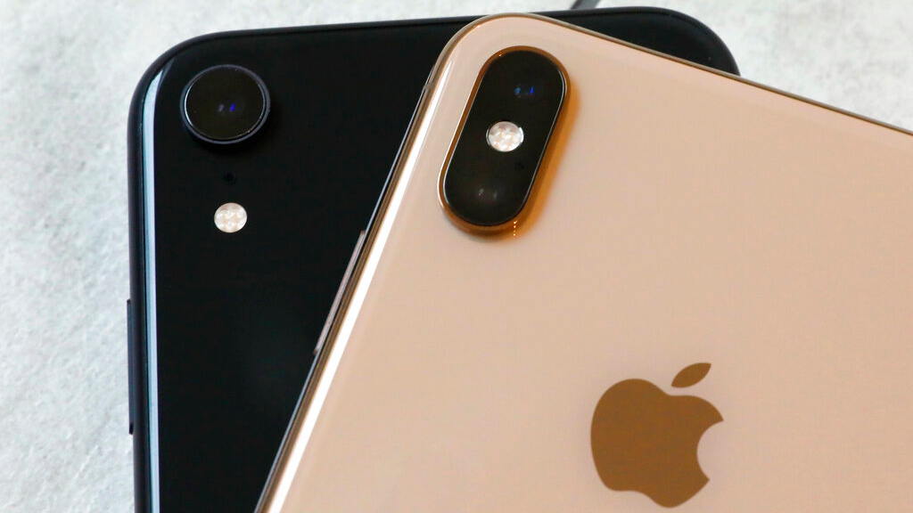 This Oct. 22, 2018, file photo shows the iPhone XR, left, that has a single lens, and the iPhone XS Max that has two lenses, in New York.