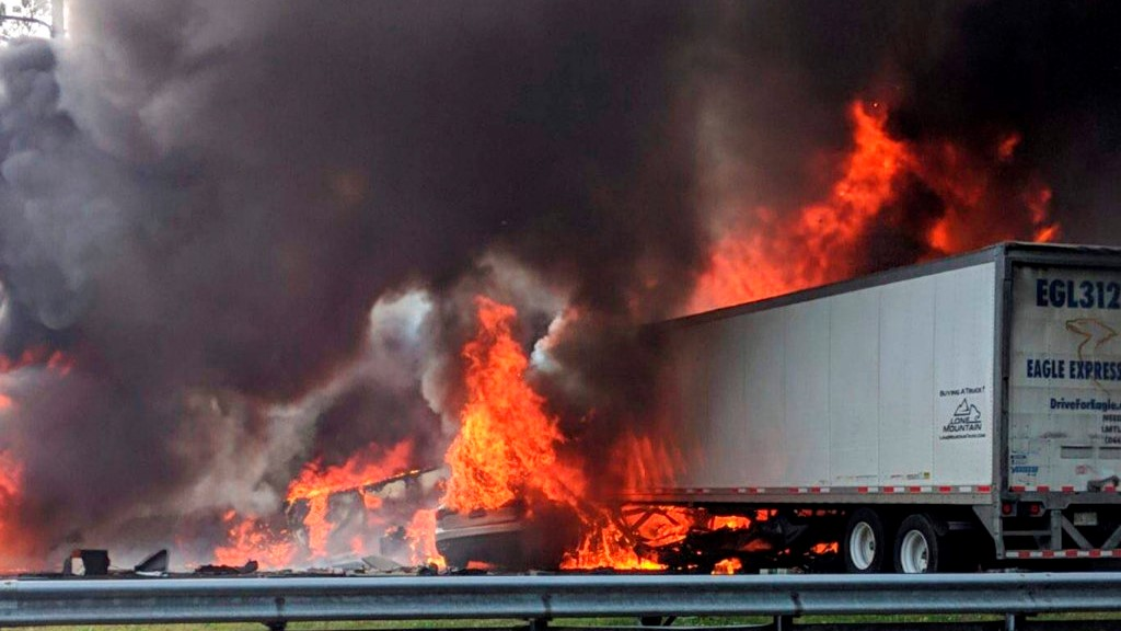 Flames engulf vehicles after a fiery crash along Interstate 75, Thursday, Jan. 3, 2019, about a mile south of Alachua, near Gainesville, Florida (WGFL-Gainesville via AP)