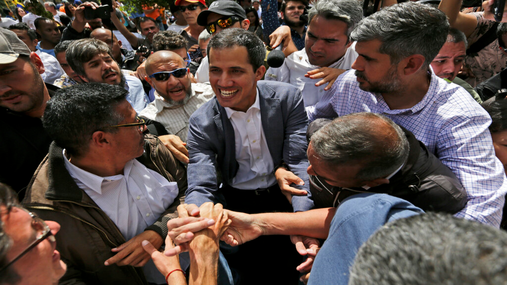 Venezuela's self-declared interim leader Juan Guaido, center, greets supporters after a rally at a public plaza in Las Mercedes neighborhood of Caracas, Venezuela, Saturday, Jan. 29, 2019. Venezuela's political showdown moves to the United Nations where a Security Council meeting called by the United States will pit backers of President Nicolas Maduro against the Trump administration and supporters of Guaido.(AP Photo/Fernando Llano)