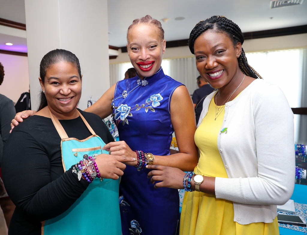 •	Patron of Sagicor Sigma Run 2019, Supermodel, Stacey McKenzie (centre); shows off her Arm Candy bracelets with The Original Arm Candy designer, Gianna Fakhourie (left) and Assistant Manager, Public Relations and Corporate Social Responsibility, Sagicor Group Jamaica, Michelle-Ann Letman (right), during the launch of the 2019 Sagicor Sigma Corporate Run on Wednesday.