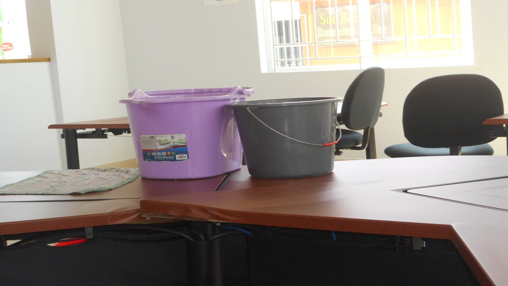 Buckets placed on a table at the ICT Centre to collect water which usually pours from the air condition unit