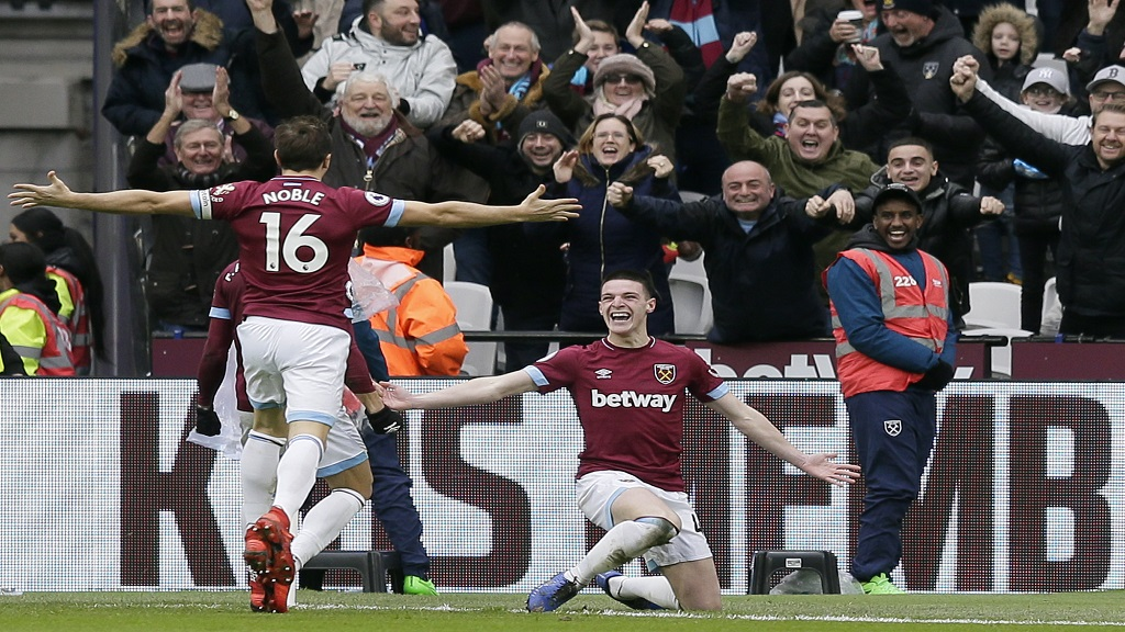 West Ham's Declan Rice, right, celebrates after scoring during the English Premier League football match against Arsenal at London Stadium in London, Saturday, Jan. 12, 2019.