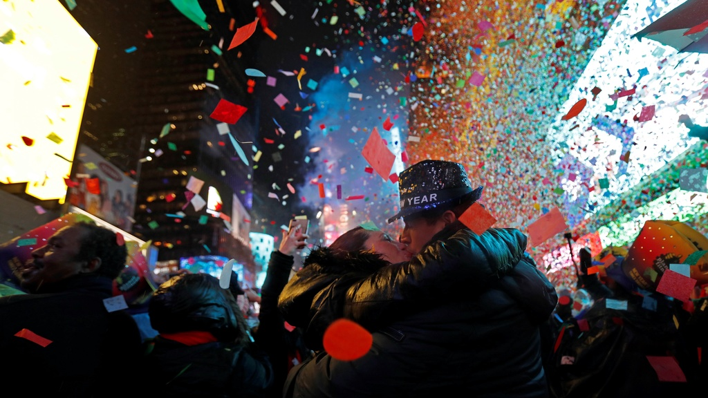 Joey and Claudia Flores, of California, kiss as confetti falls during a New Year's celebration in New York's Times Square, Tuesday, Jan. 1, 2019. (AP Photo/Adam Hunger)