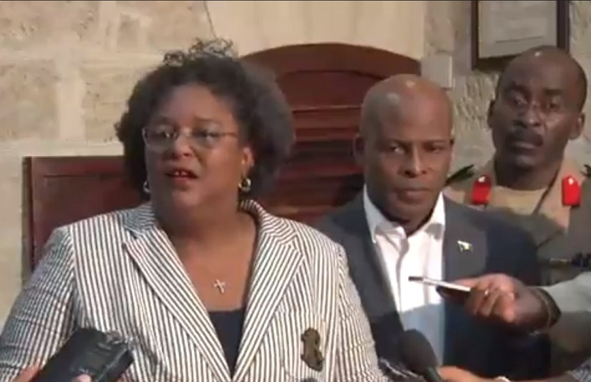 Prime Minister Mia Amor Mottley speaking to the media at Parliament on Friday. Also pictured is Minister of Home Affairs, Edmund Hinkson and Chief of Staff of the Barbados Defence Force, Colonel Glyne Grannum. (GP)