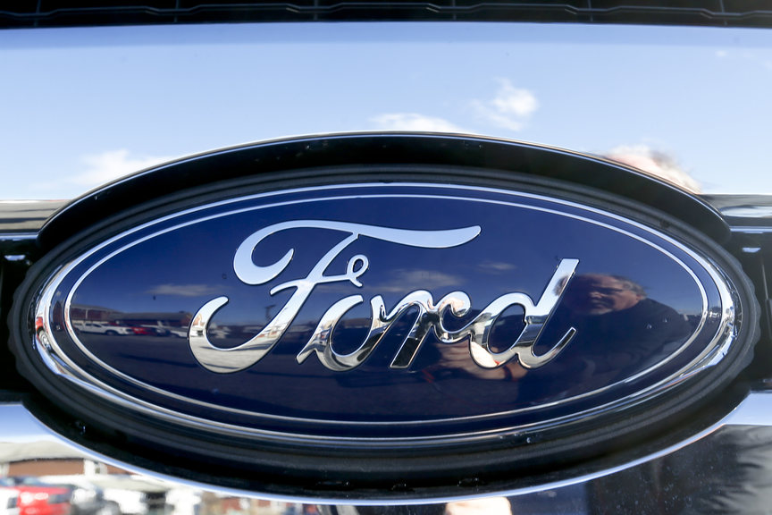 FILE - This Nov. 19, 2015 file photo shows the blue Ford oval badge in the grill of a pickup truck on the sales lot at Butler County Ford in Butler, Pa.(AP Photo/Keith Srakocic, File)