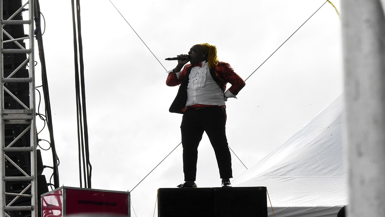 Elephant Man in full flight, performing on a speaker box.