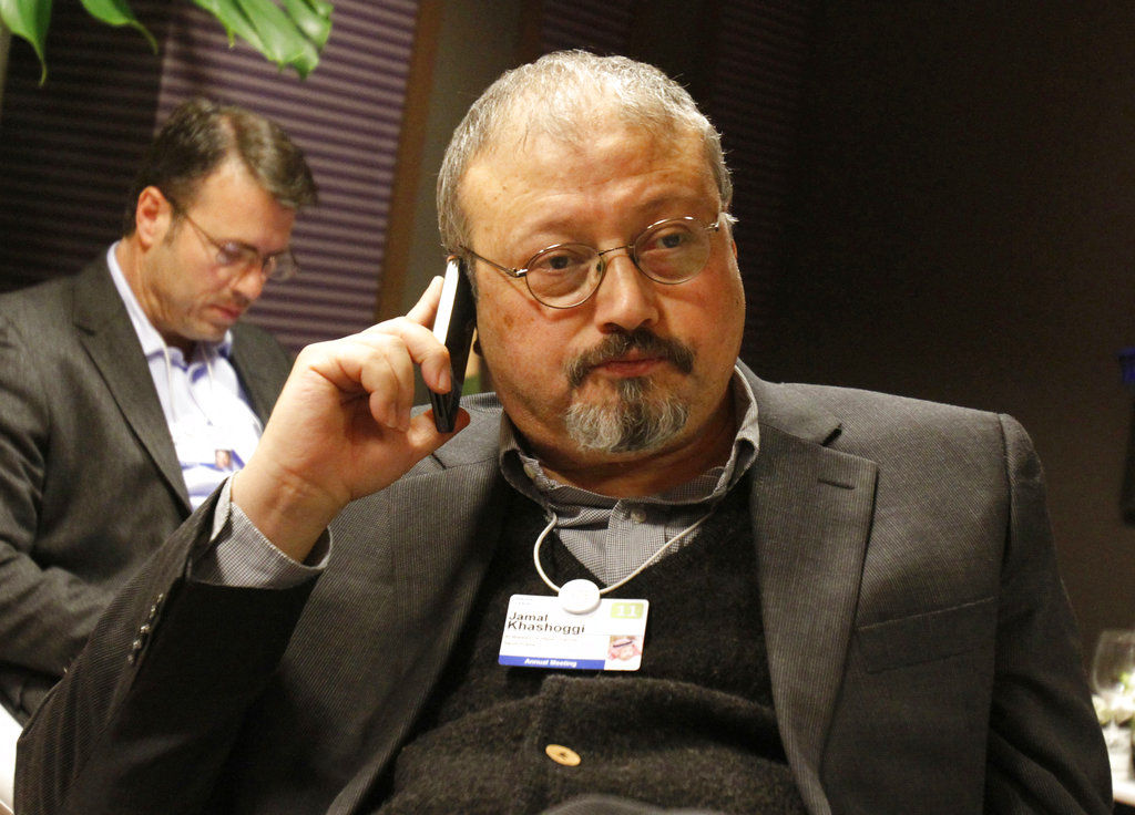 Saudi Arabian journalist Jamal Khashoggi speaks on his cellphone at the World Economic Forum in Davos, Switzerland. Saudi Arabia issued an unusually strong rebuke of the U.S. (AP Photo/Virginia Mayo, File)