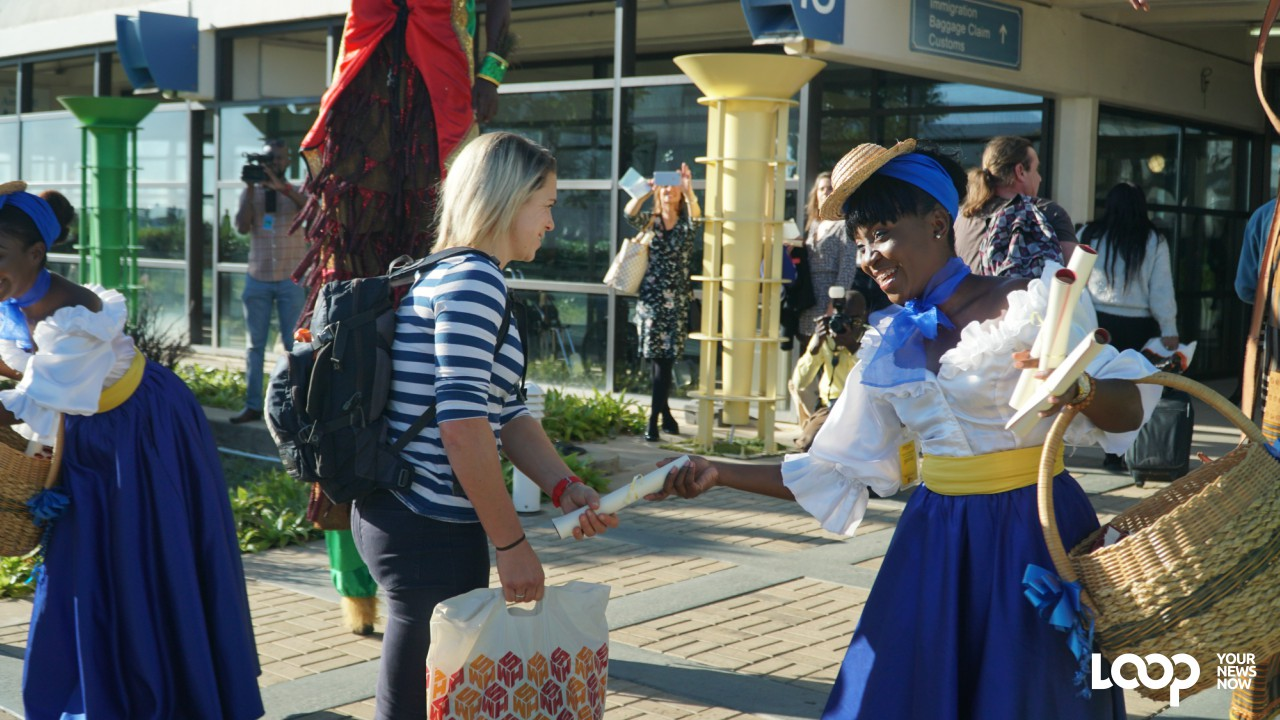 Passenger being welcomed by dancer at the Grantley Adams International Airport (PHOTO: Richard Grimes)