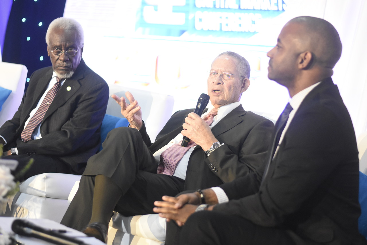 Former prime minister Bruce Golding (centre) makes a point in a panel discussion at the JSE conference, which featured former Jamaican prime ministers. Listening on are former PM PJ Patterson (left) and Steven Gooden (right), NCB Capital Markets CEO. (Photo: Marlon Reid)