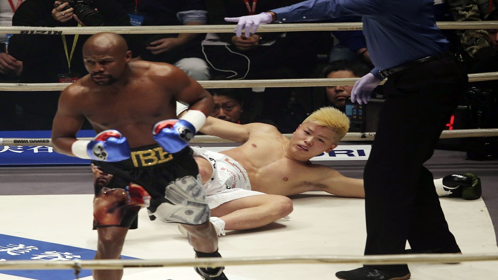Japanese kickboxer Tenshin Nasukawa lies on the mat after being knocked out by Floyd Mayweather Jr. during first round of their three-round exhibition match on New Year's Eve, at Saitama Super Arena in Saitama, north of Tokyo, Monday, Dec. 31, 2018.