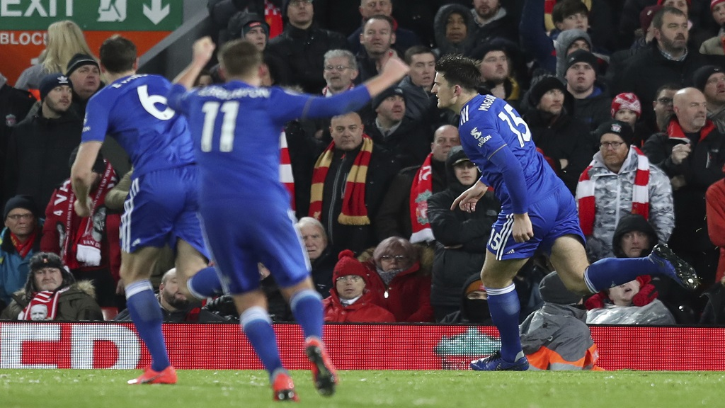 Leicester City defender Harry Maguire, right, celebrates after scoring his side goal, during the English Premier League football match against Liverpool at Anfield Stadium, Liverpool, England, Wednesday, Jan.29, 2019. In foreground is Liverpool forward Mohamed Salah.
