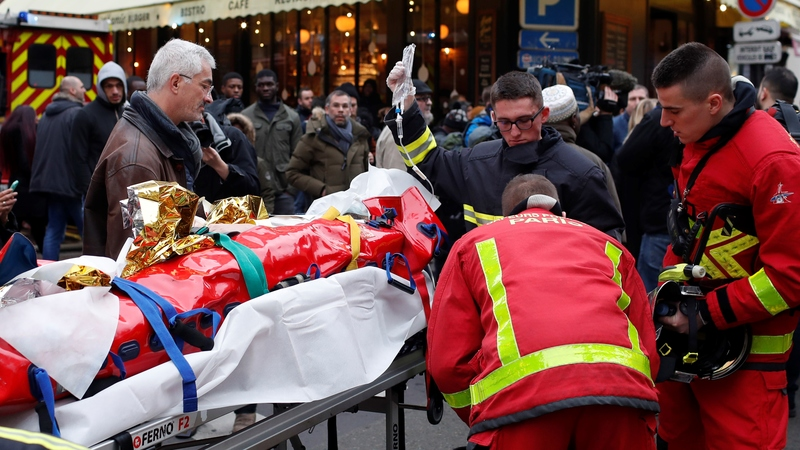 Firefighters evacuate a wounded man on a stretcher from the scene of a gas leak explosion in Paris, France, Saturday, Jan. 12, 2019. A powerful explosion and fire apparently caused by a gas leak at a Paris bakery Saturday injured several people, blasted out windows and overturned cars, police said. (AP Photo/Thibault Camus)