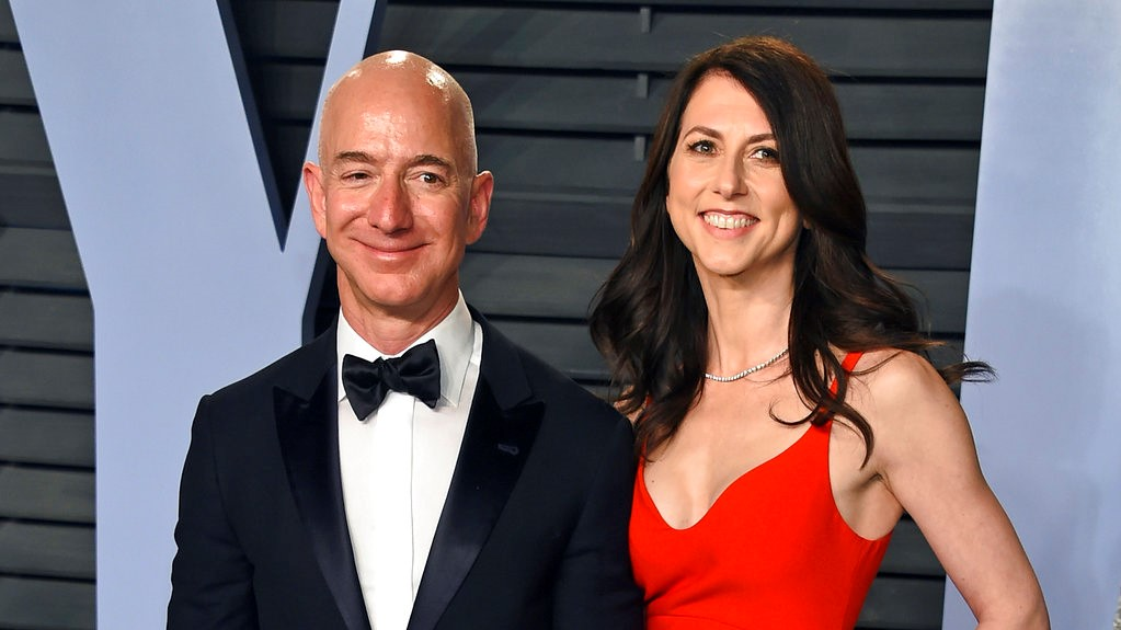 In this March 4, 2018 file photo, Jeff Bezos and wife MacKenzie Bezos arrive at the Vanity Fair Oscar Party in Beverly Hills, Calif. (Photo by Evan Agostini/Invision/AP, File)