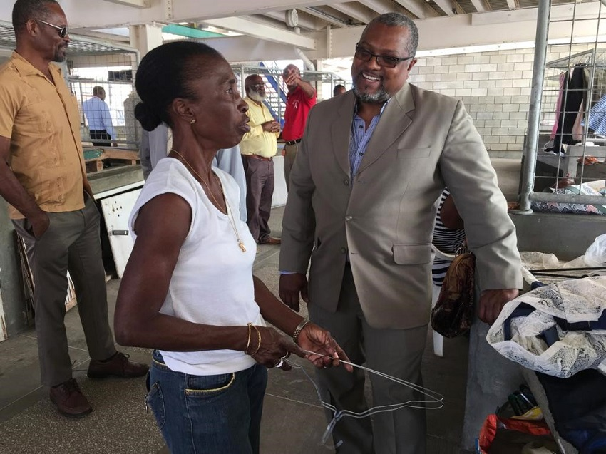 Minister of Agriculture and Food Security, Indar Weir, speaking to a vendor while on tour on the Eagle Hall Market. (BGIS)