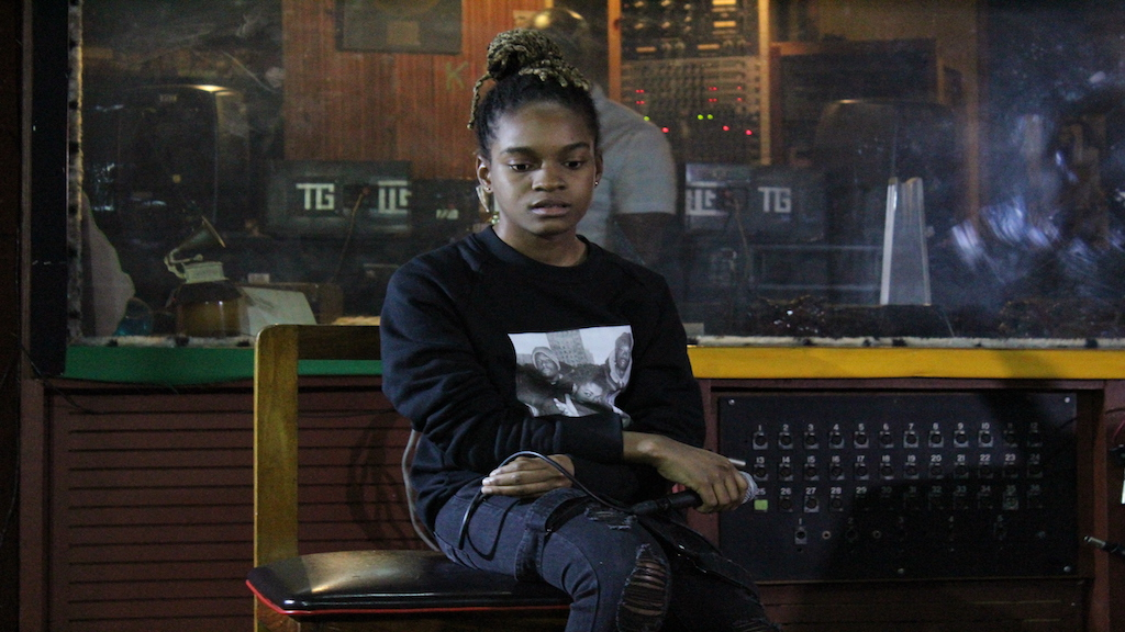 Koffee listens attentively to one of the tracks on her upcoming EP, Rapture, during a listening session at the Tuff Gong recording studio in Kingston.