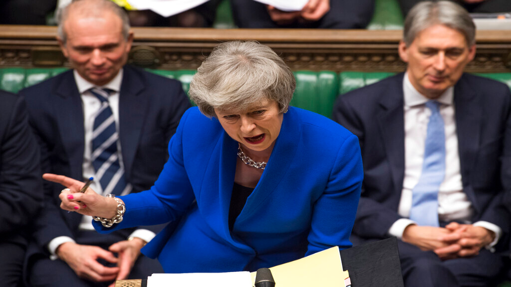 Britain's Prime Minister Theresa May speaks during a debate before a no-confidence vote on Theresa May raised by opposition Labour Party leader Jeremy Corbyn, in the House of Commons, London, Wednesday Jan. 16, 2019. In a historic defeat for the government Tuesday, Britain's Parliament discarded May's Brexit deal to split from the European Union, and May now faces a parliamentary vote of no-confidence Wednesday. (Mark Duffy, UK Parliament via AP)