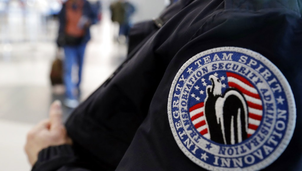 "In this Dec. 25, 2018 file photo, a TSA worker works at O'Hare International Airport in Chicago. The federal agency tasked with guaranteeing U.S. airport security is acknowledging an increase in the number of its employees calling off work during the partial government shutdown.The agency said wait times may be affected but so far ""remain well within TSA standards."" (AP Photo/Nam Y. Huh)"