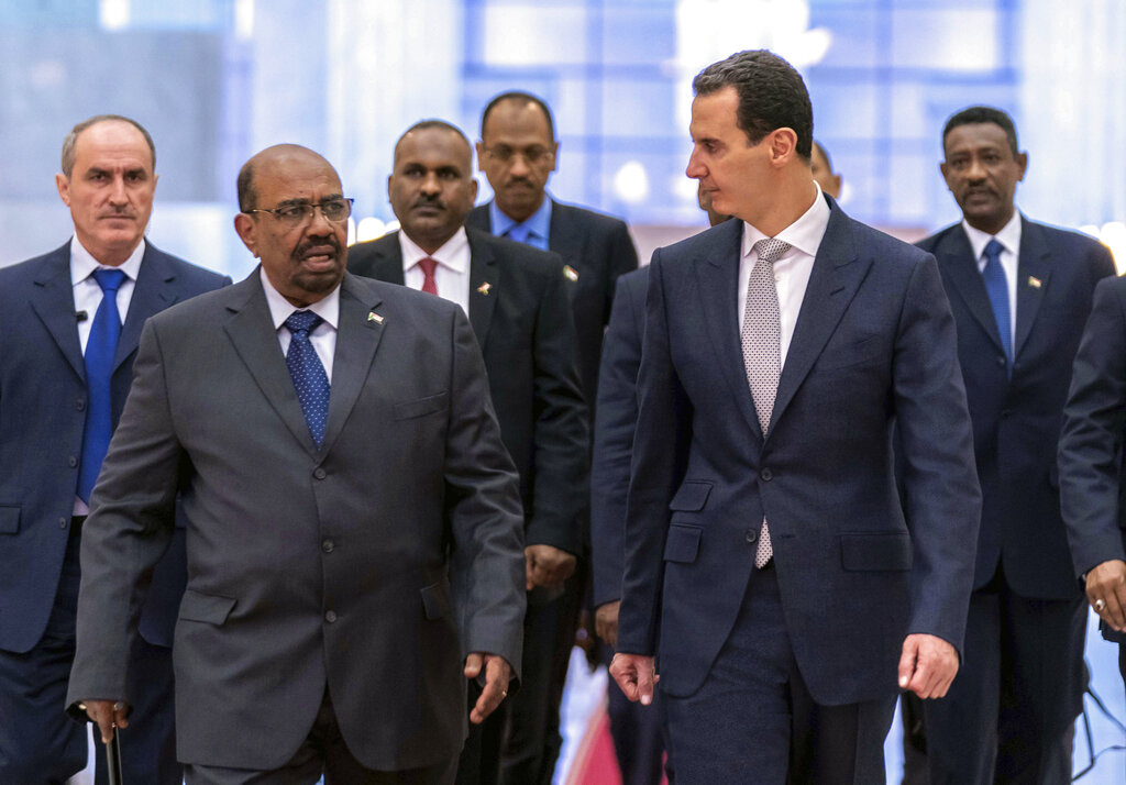 Syrian President Bashar Assad, right, meets with Sudan's President Omar Bashir in Damascus, Syria. (SANA via AP, File)