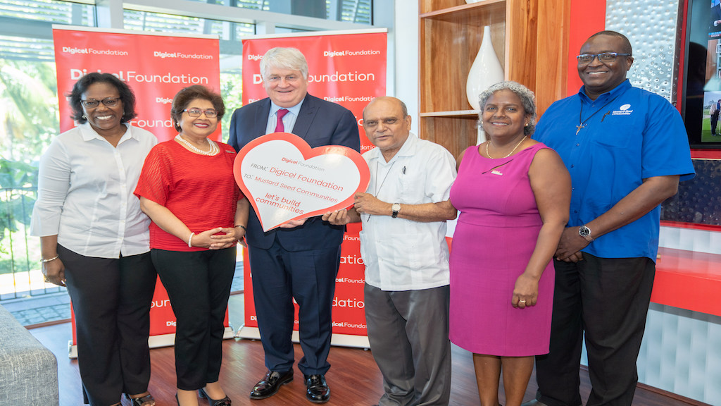 (From left) Executive Director of Mustard Seed Communities Jamaica (MSC), Darcy Tulloch-Williams; Digicel Jamaica Foundation Chairman Jean Lowrie-Chin; Digicel Chairman Denis O'Brien; MSC Founder Monsignor Gregory Ramkissoon; Digicel Jamaica Foundation CEO Karlene Dawson and Father Garvin Augustine, Executive Director of MSC International were all smiles as they celebrated a J$16.5 million grant from the Digicel Foundation for the construction of a multi-purpose facility at MSC Jerusalem in St Catherine.