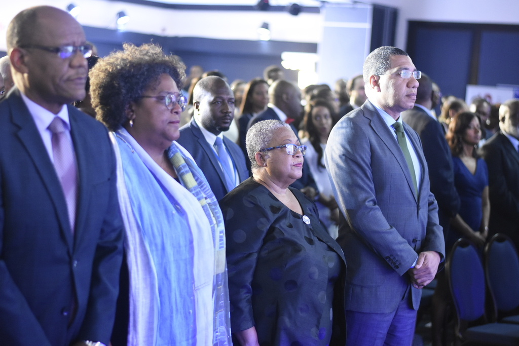 Prime Ministers Andrew Holness of Jamaica and Mia Mottley of Barbados, lead a large number of dignitaries in attendance that included ministers of government, diplomats, corporate executives and representatives of regional stock exchanges. (Photos: Marlon Reid)