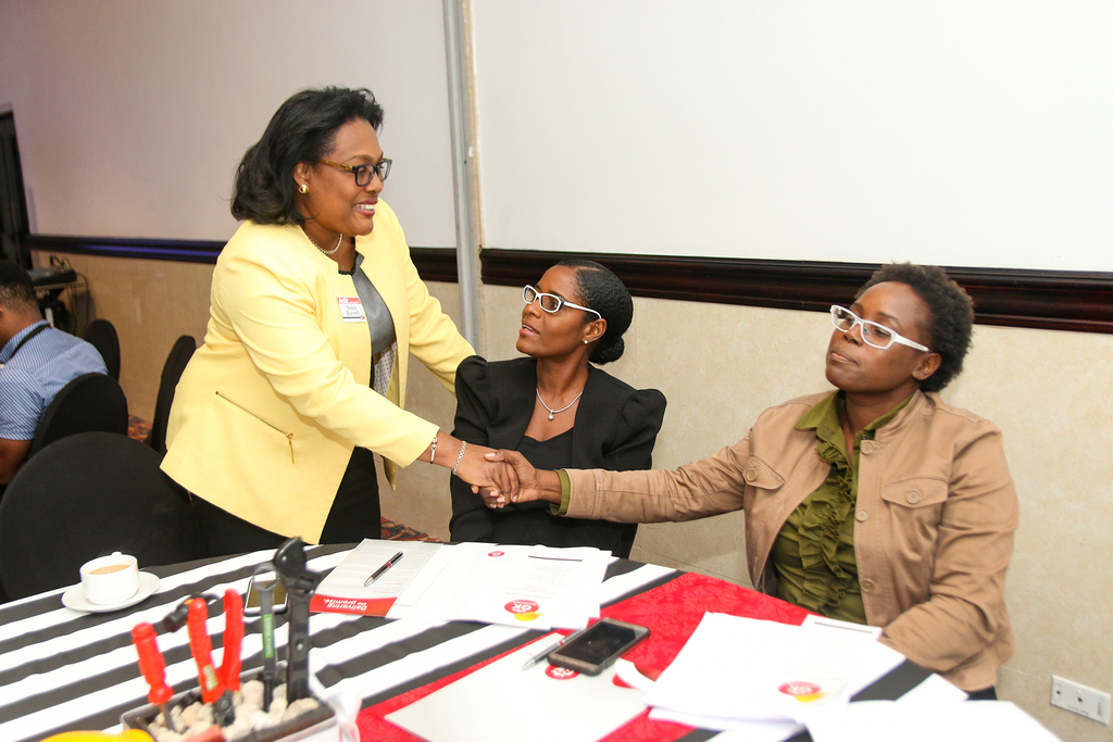 Grace Burnett (left), Managing Director of GK Insurance, greets guests from Jamaica Social Investment Fund Donna Thompson (centre), Senior Financial Analyst, and Keslyn GilbertStoney, Manager, Legal & Governance, at the first annual staging of the GKI Contractors Forum.