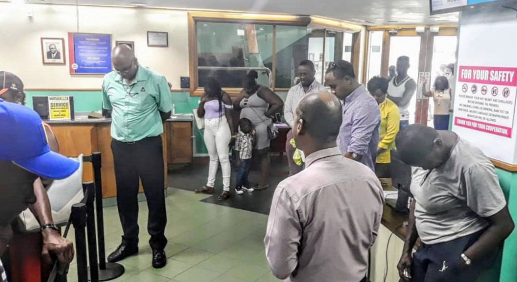 Minute of prayer being observed at the City of Bridgetown Credit Union. 