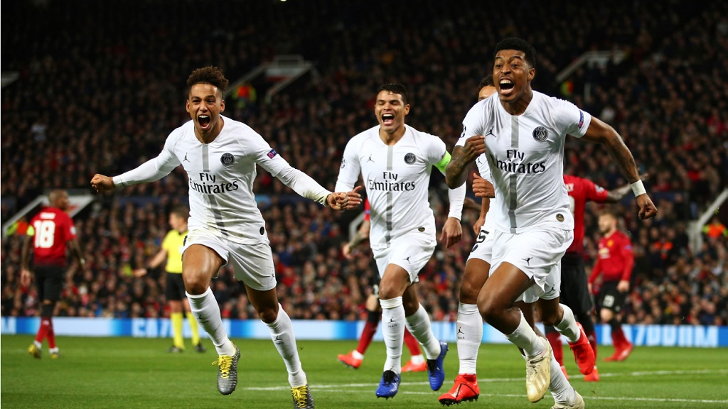 PSG's Presnel Kimpembe, right, celebrates with teammates after scoring the opening goal in their Champions League round of 16 match against Manchester United  at Old Trafford in Manchester, England, Tuesday, Feb. 12, 2019.