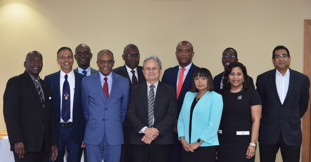 Finance Minister Colm Imbert (centre), flanked by newly appointed and former appointees of the Central Bank Board.