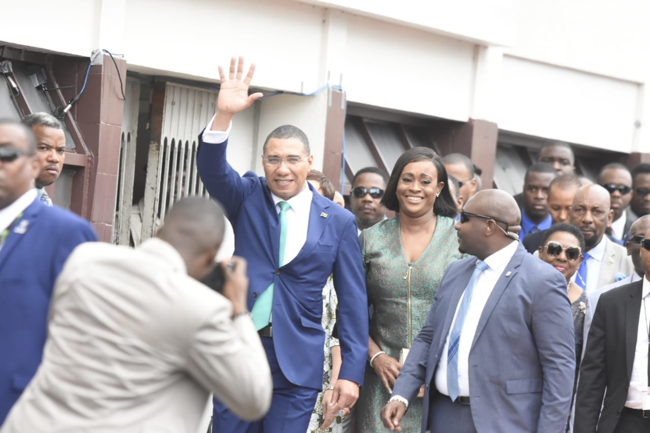 Prime Minister Andrew Holness, pictured alongside his wife, Member of Parliament Juliet Holness, waves to supporters as he entered Gordon House for the ceremonial opening of Parliament on Thursday. (PHOTOS: Marlon Reid)