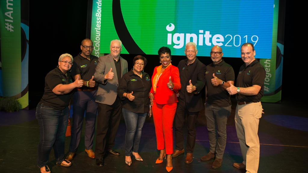 A mix of the Sagicor Life Inc and Sagicor General Insurance Inc senior management team and motivational speaker and internationally-renowned US actress Sheryl Lee Ralph (in red) give a thumbs-up after an inspiring Ignite event. Ignite is one of the first events in the Sagicor calendar and is geared towards updating staff on the strategic direction of the organisation and motivating them to achieve sales targets.