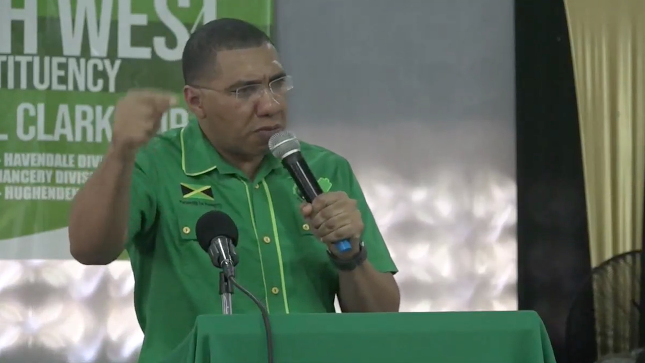Prime Minister and Jamaica Labour Party Leader, Andrew Holness speaks at a JLP Area One meeting at the Pembroke Hall Community Centre in St Andrew on Sunday.