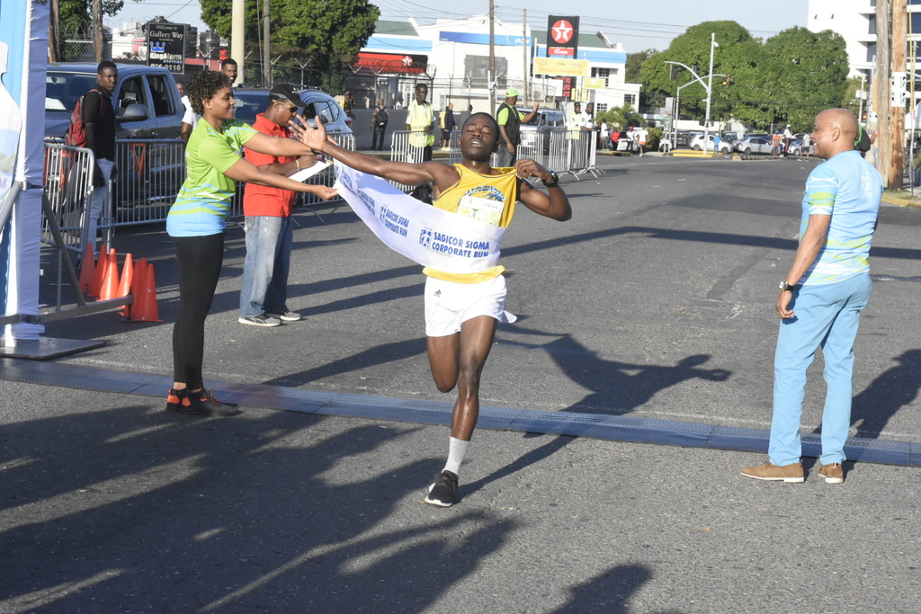 Henry Thomas of UCT Steppers hitting the finish-line to win the men's section of the the Sigma Run at Emancipation Park, New Kingston on Sunday morning. (Photos: Marlon Reid)