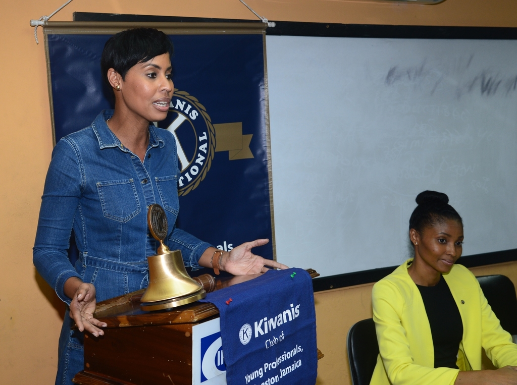 Public relations consultant and author Naomi Garrick (standing, left) as she shares pointers on the topic, 'The Brand You' during the Kiwanis Club of Young Professionals Kingston, Jamaica monthly meeting held recently (January 16) at the College of Insurance and Professional Studies. Listening on is, Naketa West, president of the club.