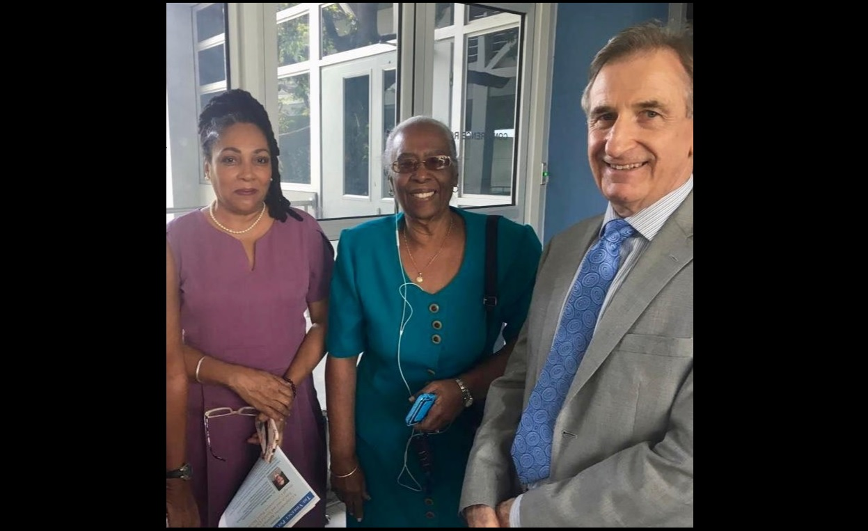 Dr Ashley Deans (right) interacts with (from left) Karen Ayee of the Jamaica Foundation for Consciousness-Based Education and Deanna Ashley, Executive Director of the Violence Prevention Alliance.