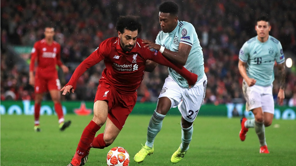 Liverpool's Mohamed Salah , left and Bayern Munich's David Alaba battle for the ball, during their Champions League round of 16 first leg football match at Anfield, in Liverpool, England, Tuesday, Feb. 19, 2019.