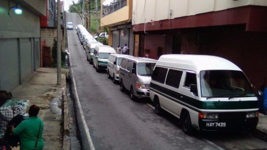 Chaguanas maxis in queue at their temporary location at Short Street, San Fernando